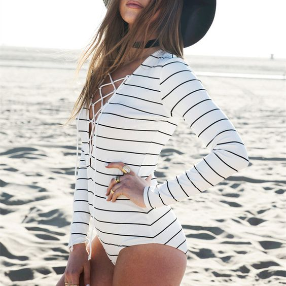 black and white long sleeve bathing suit with a front lace up