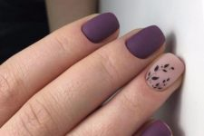 03 matte deep purple nails with an accent blush one and with a foliage pattern