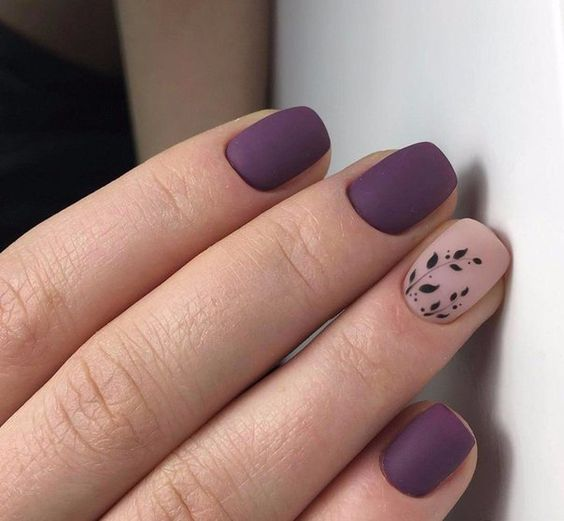 matte deep purple nails with an accent blush one and with a foliage pattern