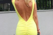 04 a bold yellow knee dress with a deep V back cutout and no sleeves