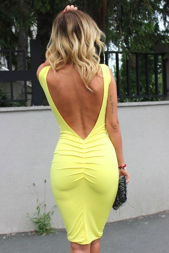 a bold yellow knee dress with a deep V back cutout and no sleeves