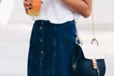 04 a denim mini skirt with a button row and a white V-neckline t-shirt