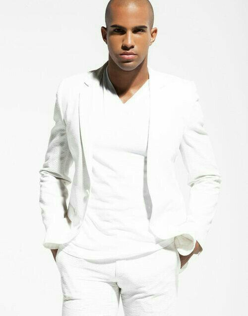 a white v-neck tee, a white jacket, white pants