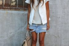 05 a distressed denim mini skirt, a grey t-shirt, a white vest and ankle strap shoes