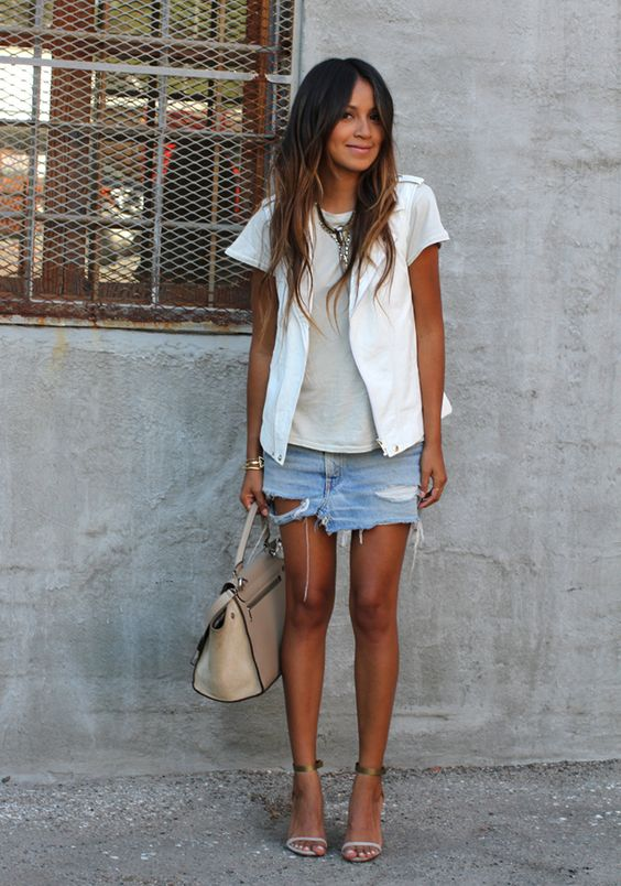 a distressed denim mini skirt, a grey t-shirt, a white vest and ankle strap shoes