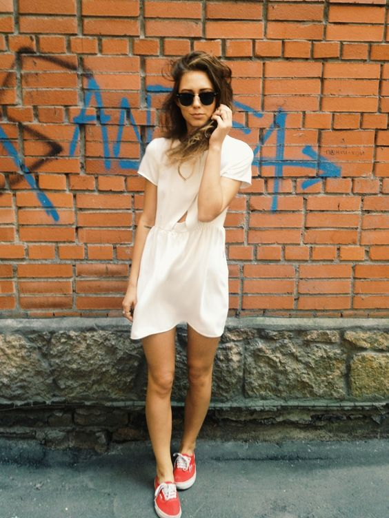 a plain white mini dress with short sleeves and red chucks