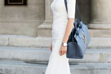 05 a white fitting midi dress with short sleeves and with nude heels