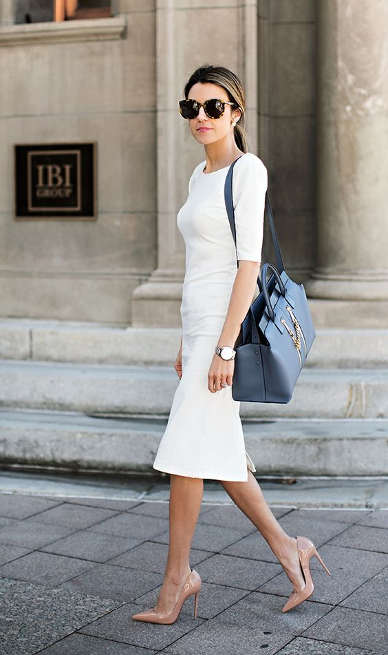 a white fitting midi dress with short sleeves and with nude heels