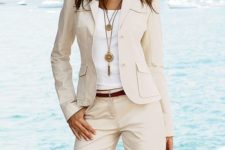 05 an ivory shorts suit with a white top and a boho necklace