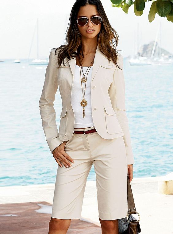 an ivory shorts suit with a white top and a boho necklace