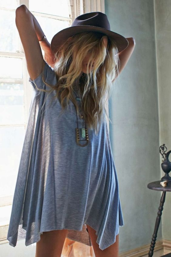 an oversized grey t shirt is worn here like a dress with a hat and some boho accessories