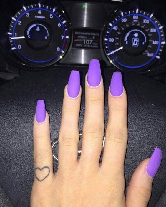 matte purple nails look very bold and chic