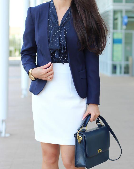 a white knee skirt, a navy polka dot shirt and a navy blazer