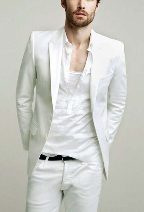 a white suit, a white shirt and a white tee under it for a layered look