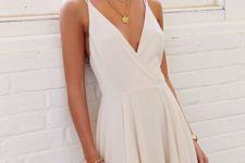 06 deep V-neck white mini dress with straps is a simple and elegant solution