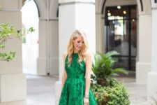 06 sleeveless emerald green floral print dress with a halter neckline and nude shoes