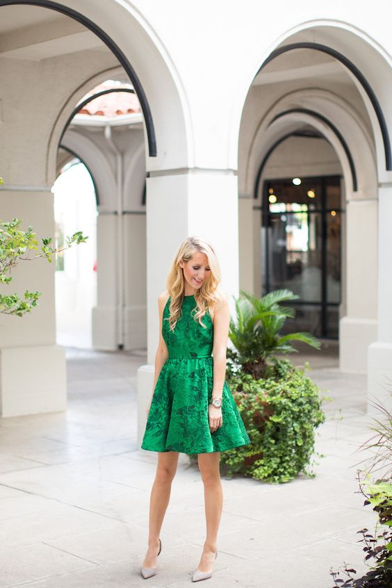 sleeveless emerald green floral print dress with a halter neckline and nude shoes