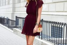 07 a burgundy pleated mini dress with cap sleeves and neutral heels with ankle straps