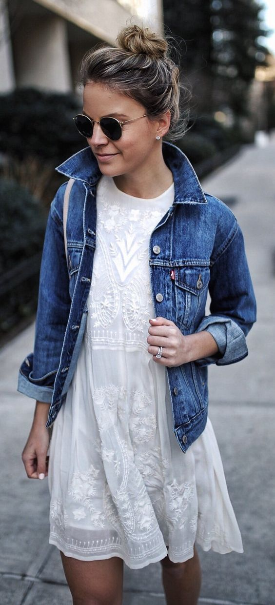 a white lace dress with a denim jacket