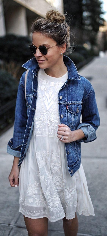 a white lace dress with a denim jacket