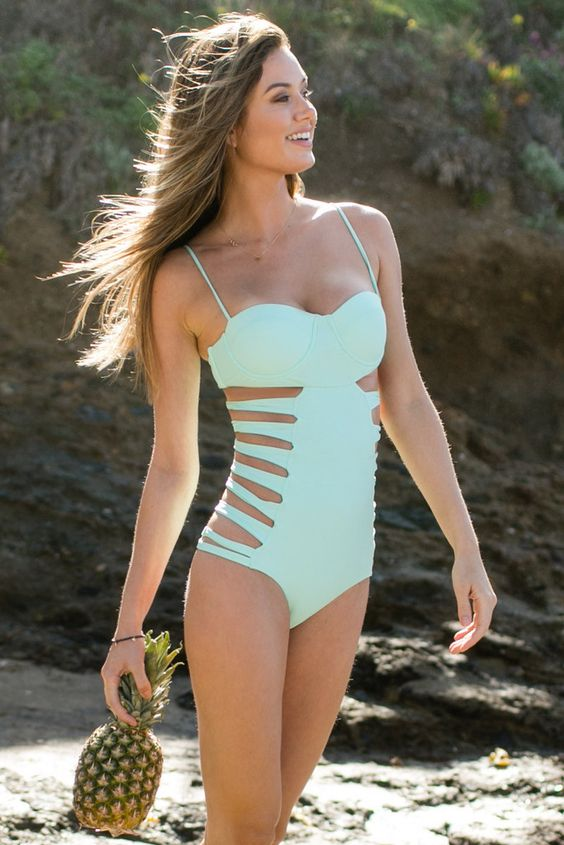mint-colored one-piece spaghetti strap swimsuit with side straps
