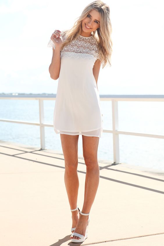 white mini short sleeve dress with a lace top