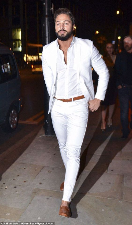 white pants, a white shirt, a white jacket, copper shoes and a belt for a colorful touch