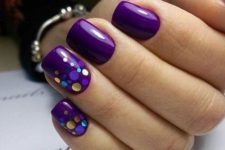 08 bold purple nails with two accent ones covered with sparkling polka dots