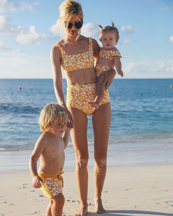 retro-inspired two piece high waist swimsuit for the mom and daughter and the son in matching swimming trunks