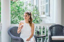 08 white halter neckline dress with a side slit, nude heels and a pink bag