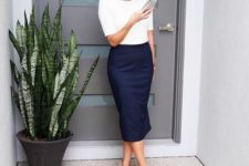 09 a navy midi pencil skirt, a white shirt with short sleeves and neutral heels
