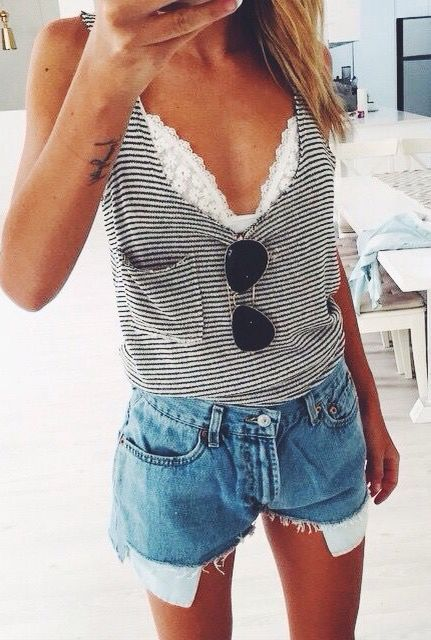 a white lace bralette under a striped top with denim shorts