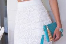09 a white lace separate with a sleeveless crop top and a pencil skirt, a turquoise clutch