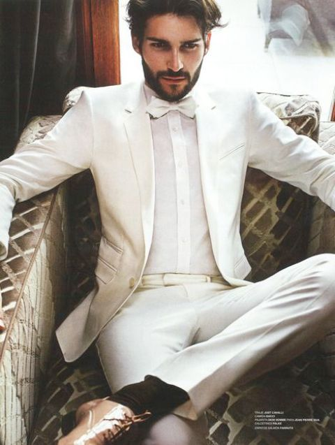 a white suit, a white shirt and bow tie, copper shoes for a formal white party