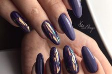 09 dark purple almond-shaped nails and accent ones with graphic designs