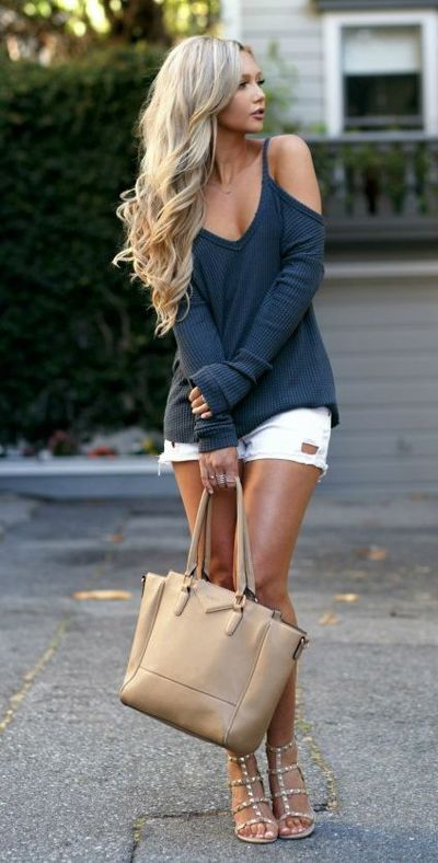 a grey long sleeve cold shoulder top, white shorts and spiked sandals