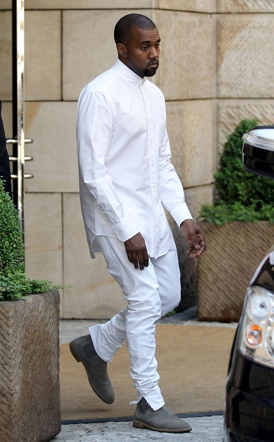 a long white shirt over white jeans and grey suede boots