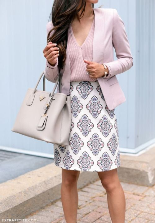 a patterned knee skirt, a striped pink V-neckline top and a pink jacket