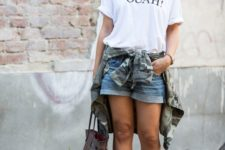 10 a printed oversized white t-shirt, denim shorts, ankle strap shoes