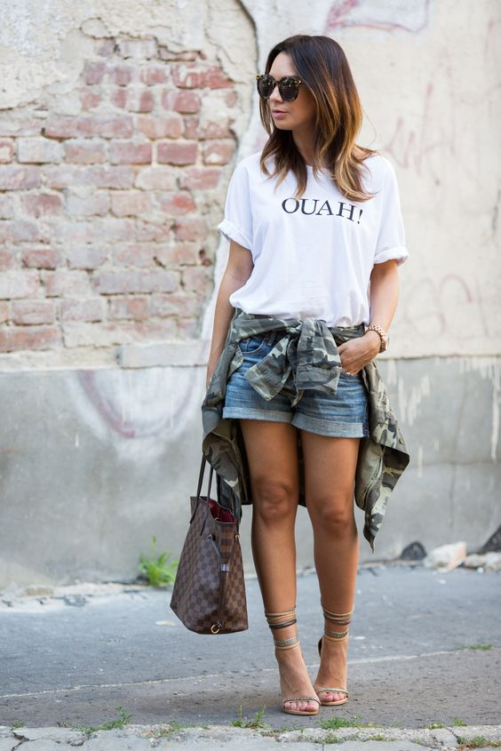 a printed oversized white t shirt, denim shorts, ankle strap shoes
