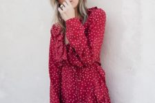10 a red polka dot wrap dress with ruffles and long sleeves