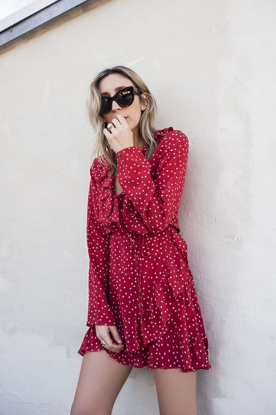 a red polka dot wrap dress with ruffles and long sleeves