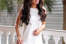 10 a white mini dress with a ruffled edge and no sleeves, a white bag