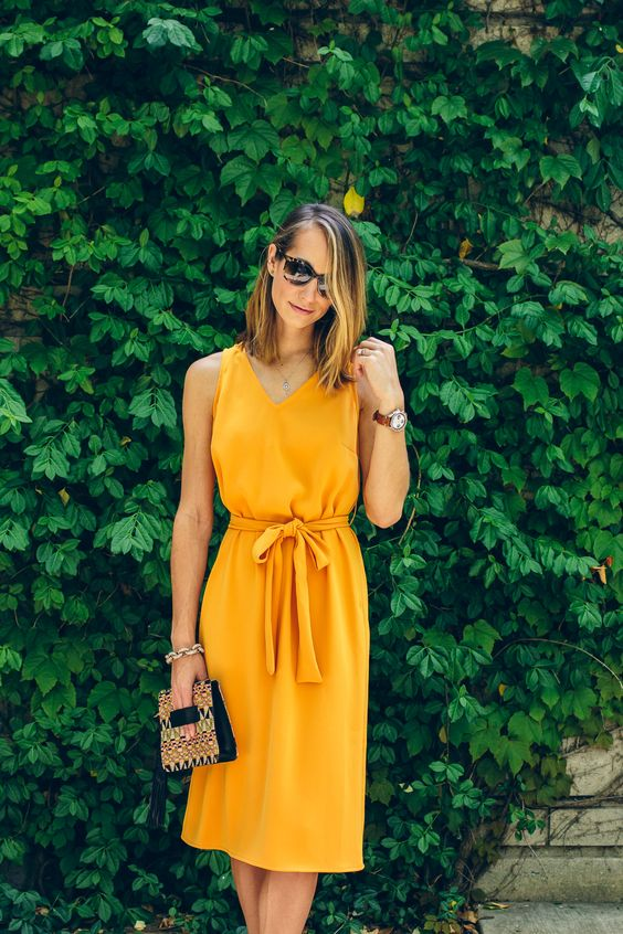 casual yellow knee dress with a V-neckline and a sash is a comfy idea