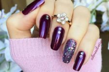 10 deep purple nails with an accent glitter nail and rhinestones