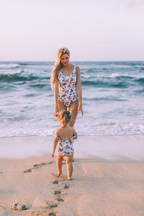 matching classic one piece swimsuits with botanical and floral prints for both girls