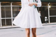 10 white perforated mini dress with a V-neckline and ankle strap heels