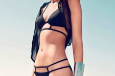 11 a black bikini with a strappy top and bottom