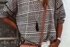 11 a printed shirt and white shorts, a brown cross body bag