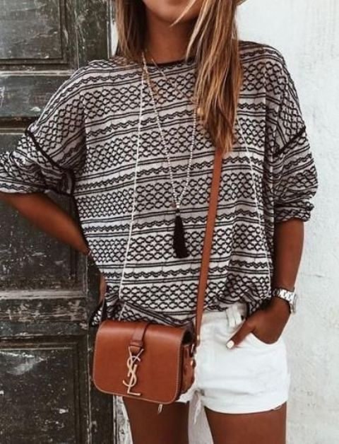 a printed shirt and white shorts, a brown cross body bag